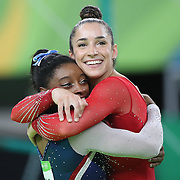 Gymnastics - Olympics: Day 6 Simone Biles #391 of the United State and Alexandra Raisman #395 of the United States embrace as the final result comes through confirming Gold and Silver for the pair during the Artistic Gymnastics Women's Individual All-Around Final at the Rio Olympic Arena on August 11, 2016 in Rio de Janeiro, Brazil. (Photo by Tim Clayton/Corbis via Getty Images)