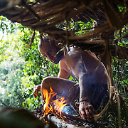 Lone Survivor, Venezuela Episode. Ed Stafford work on a try to set up a fire in his based camp in the middle of the jungle in the Canaima National park in the Venezuela Gran Sabana©  Discovery Communications/ Tito Hererra
