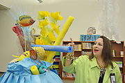 """HISD Schools Office Director Siomara Saenz Phillips admires the library decorations in keeping with the theme """"Books are Treasures Waiting to be Discovered."""""""