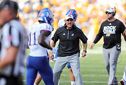 Oct 6, 2018; Morgantown, WV, USA; Kansas Jayhawks head coach David Beaty celebrates with teammates after scoring a touchdown during the third quarter against the West Virginia Mountaineers at Mountaineer Field at Milan Puskar Stadium. Mandatory Credit: Ben Queen-USA TODAY Sports