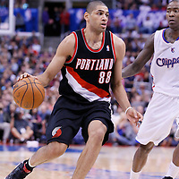 12 February 2014: Portland Trail Blazers small forward Nicolas Batum (88) drives past Los Angeles Clippers shooting guard Jamal Crawford (11) during the Los Angeles Clippers 122-117 victory over the Portland Trail Blazers at the Staples Center, Los Angeles, California, USA.