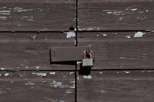 An old locked padlock secures a old wooden door. & Brown Secured Doors | FahrmannPhoto.com Pezcame.Com