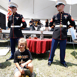 June 8, 2010; Buras, LA, USA; Seven year old Sydney Ragas poses for a picture with the Vince Lombardi Trophy during a New Orleans Saints rally held at Fort Jackson. The entire team held a rally at Fort Jackson and visited with members of the small Plaquemines Parish fishing community of Buras that has been impacted by the oil spill. (Photographer: Derick E. Hingle).