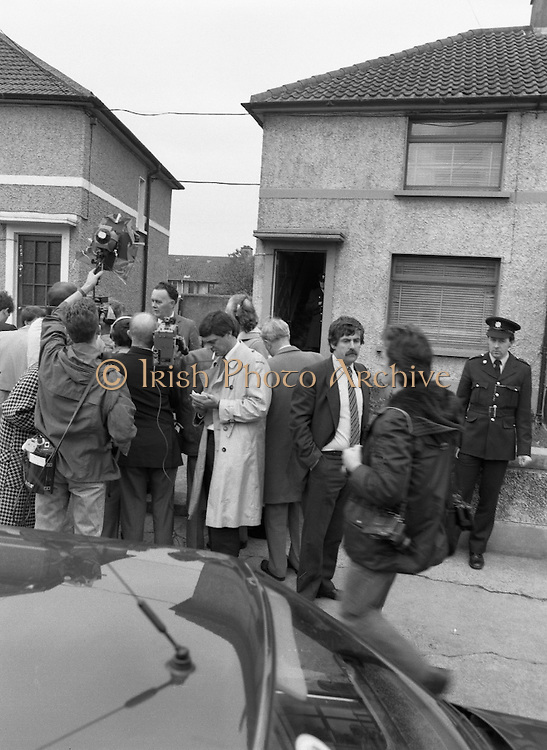 """John O'Grady Rescued By Gardai.   (R67)..1987..05.11.1987..11.05.1987..5th November 1987..After being kidnapped from his home in Cabinteely, Co Dublin, John O'Grady was finally rescued after twenty one days in captivity. he was located in a house inCarnlough Road, Cabra West, Dublin. During his ordeal Mr O""""Grady was mutilated by the kidnappers led by Dessie O'Hare to apply pressure on his family to pay the ransom sought. In an ensuing gun battle with the kidnappers a detective garda was shot and seriously wounded. In the chaos that followed the kidnappers escaped and were not all captured for a further three weeks after a massive manhunt...Image shows Supt Reynolds, the officer in charge of the kidnap case, speaking with reporters outside he house in Carnlough Road, Cabra."""