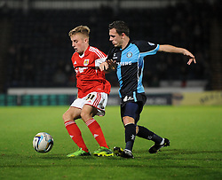 Bristol City's Joe Morrell controls the ball under pressure from Wycombe Wanderers' Josh Scowen - Photo mandatory by-line: Joe Dent/JMP - Tel: Mobile: 07966 386802 08/10/2013 - SPORT - FOOTBALL - London Road Stadium - Peterborough - Peterborough United V Brentford - Johnstone Paint Trophy