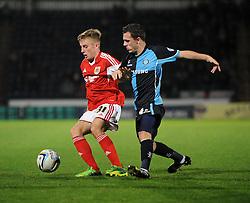 Bristol City's Joe Morrell controls the ball under pressure from Wycombe Wanderers' Josh Scowen - Photo mandatory by-line: Joe Dent/JMP - Tel: Mobile: 07966 386802 08/10/2013 - SPORT - FOOTBALL - London Road Stadium - Peterborough - Peterborough United V Brentford - Johnstone Paint Trophy