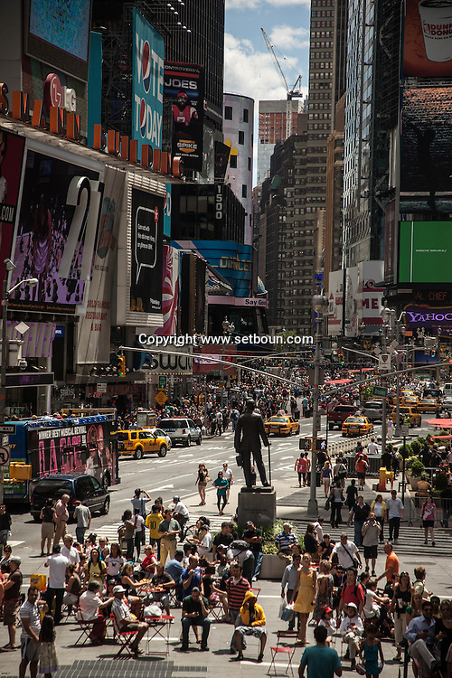 New York , Times square , crowd , yellow cabs and advertising bilboard ,  boadway and sixth avenue .  Manhattan - United states