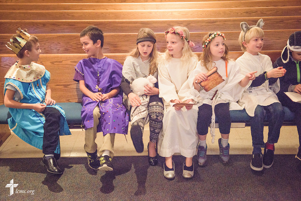 Third grade students dressed for a theatrical production sit before chapel on Friday, Oct. 28, 2016, at First Immanuel Lutheran School in Cedarburg, Wis. LCMS Communications/Erik M. Lunsford