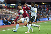 Derby County defender (on loan from Chelsea) Fikayo Tomori (5) battles for possession  with Aston Villa forward Andre Green (19) during the EFL Sky Bet Championship match between Aston Villa and Derby County at Villa Park, Birmingham, England on 2 March 2019.