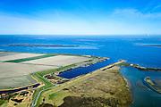 Nederland, Zeeland, Gemeente Schouwen-Duiveland, 01-04-2016; Brouwershaven, Grevelingenmeer. Werkhaven Bommenede, gebruikt voor bouw caissons die nodig waren bij de aanleg van de Brouwersdam (links aan de horizon).<br /> Temporary port used for Deltaworks.<br /> luchtfoto (toeslag op standard tarieven);<br /> aerial photo (additional fee required);<br /> copyright foto/photo Siebe Swart