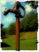 Antique water spigot against blue sky with polaroid filter