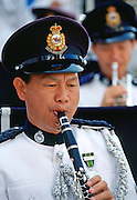Member of the Hong Kong Police force playing clarinet for the Police band