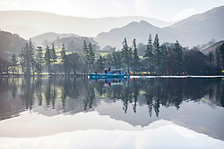 **2018 Pictures of the year by London News Pictures**<br /> © Licensed to London News Pictures. 21/02/2018. Glenridding UK. The Ullswater Steamer makes it's way from Glenridding to Pooley Bridge along the calm water of Ullswater lake this morning on a sunny day in Cumbria. Photo credit: Andrew McCaren/LNP