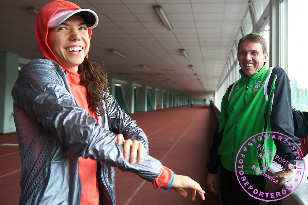 (L) Joanna Jozwik and (R) her trainer Andrzej Wolkowycki during training session on AWF at athletics stadium in Warsaw, Poland.<br /> <br /> Poland, Warsaw, August 26, 2014<br /> <br /> Picture also available in RAW (NEF) or TIFF format on special request.<br /> <br /> For editorial use only. Any commercial or promotional use requires permission.<br /> <br /> Photo by &copy; Adam Nurkiewicz / Mediasport