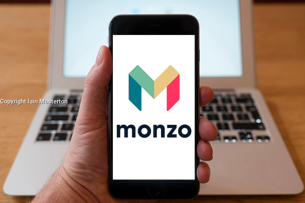 Using iPhone smart phone to display website logo of Monzo mobile banking app
