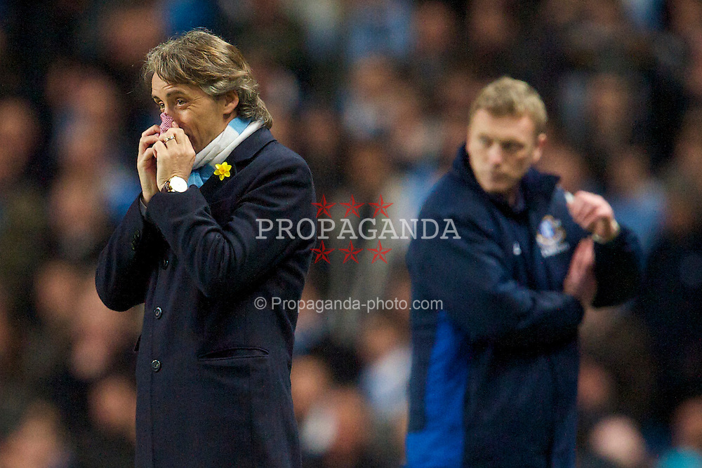 MANCHESTER, ENGLAND - Wednesday, March 24, 2010: Manchester City's manager Roberto Mancini during the Premiership match at the City of Manchester Stadium. (Photo by David Rawcliffe/Propaganda)