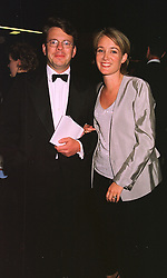 MR & MRS JAMES BAKER he is the son of the news reader and she is TV presenter Annastasia Cook, at a film premier on 26th August 1998.MJL 79