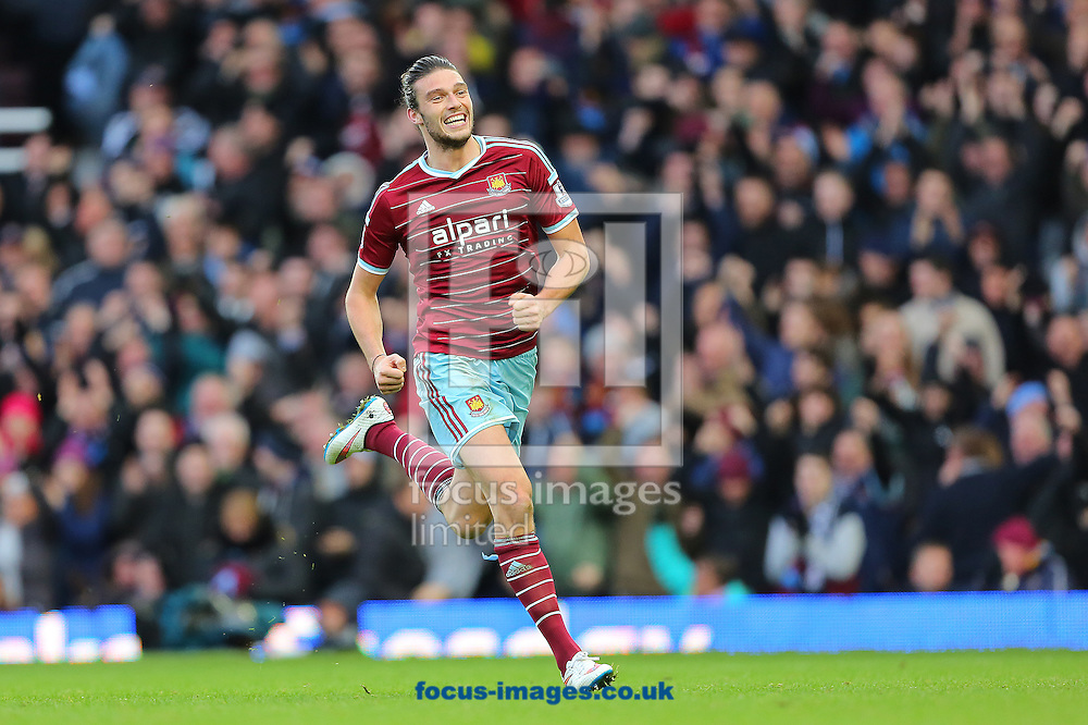 Andy Carroll of West Ham United celebrates after putting his side 2-1 ahead against Swansea City during the Barclays Premier League match at the Boleyn Ground, London<br /> Picture by Richard Calver/Focus Images Ltd +447792 981244<br /> 07/12/2014