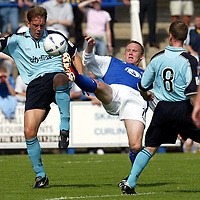 Queen of the South v St Johnstone.. 17.08.02<br />Ian Maxwell in challenge with Brian McLaughlin<br /><br />Pic by Graeme Hart<br />Copyright Perthshire Picture Agency<br />Tel: 01738 623350 / 07990 594431