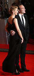 French actor Jean Dujardin arrives with his French actress wife Alexandra arrives for the 2012 ORANGE BRITISH ACADEMY FILM AWARDS, The Bafta's at The Royal Opera House, Covent Garden, London. Photo By I-Images