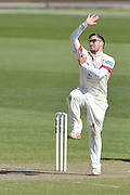 Simon Kerrigan in his deliver stride about to bowl to Chris Read (not shown) during the Specsavers County Champ Div 1 match between Lancashire County Cricket Club and Nottinghamshire County Cricket Club at the Emirates, Old Trafford, Manchester, United Kingdom on 17 April 2016. Photo by Simon Trafford.