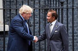 © Licensed to London News Pictures. 04/02/2020. LONDON, UK.  Hassanal Bolkiah, the Sultan of Brunei, (R) is greeted by Boris Johnson, Prime Minister, (L) ahead of talks in Number 10 Downing Street.  Photo credit: Stephen Chung/LNP