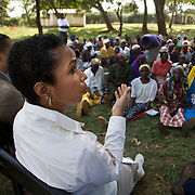 Helene Gayle, President and CEO of CARE, listens to nannies during a visit to Strenthening the House of Nanny project. This project supports 3,191 orphans and 1,027 orphans. The nannies are all over 45 years old and live with a minimum of two orphans whose parents died of HIV. The project helps the elderly nannies finance small income generating programs.