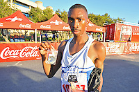 BELLVILLE, SOUTH AFRICA - Wednesday 3 December 2014, Unathi Nteta with his medal after winning the Metropolitan 10km road race outside the Parc Du Cap head office in Bellville.<br /> Photo by IMAGE SA / Roger Sedres