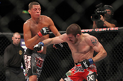 East Rutherford, NJ - May 05, 2012: Jim Miller (White trunks) and Nate Diaz (Grey and white trunks) during UFC on FOX 3 at the Izod Center in East Rutherford, New Jersey.