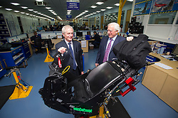 © London News Pictures. File pic date 16/07/2013. L to R John S. Martin (Joint Managing Director) and James W. Martin (Joint Managing Director) stand behind a JSF (Joint Strike Fighter) ejection seat in production at Martin-Baker, manufacturers of ejection seats and crashworthy seating systems in Denham, Buckinghamshire. The ejection seat manufacturer Martin Baker has pleaded guilty at Lincoln Crown Court to Health and Safety offences over the death of Red Arrows Pilot Sean Cunningham in 2011. Photo credit: Ben Cawthra/LNP