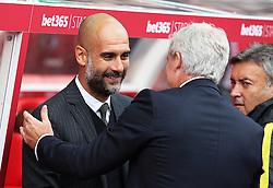 Manchester City manager Pep Guardiola greets Stoke City manager Mark Hughes  - Mandatory by-line: Matt McNulty/JMP - 20/08/2016 - FOOTBALL - Bet365 Stadium - Stoke-on-Trent, England - Stoke City v Manchester City - Premier League