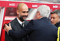Manchester City manager Pep Guardiola greets Stoke City manager Mark Hughes  - Mandatory by-line: Matt McNulty/JMP - 20/08/2016 - FOOTBALL - Bet365 Stadium - Stoke-on-Trent, England - Stoke City v Manchester City - Premier League