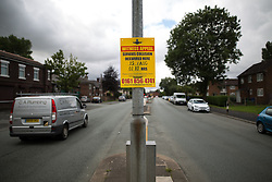 © Licensed to London News Pictures . 15/08/2015 . Manchester , UK . Scene on Lightbowne Road , Moston in Manchester where a man died following a fatal road accident in the early hours of this morning (Saturday 15th August 2015) . Police report a green Rover 25 collided with a lamppost and a passenger , believed to be 21 years old , was pronounced dead at the scene . An 18 year old passenger is in hospital with life-threatening injuries and the 19 year old driver is also in hospital , in a serious but stable condition . Photo credit : Joel Goodman/LNP