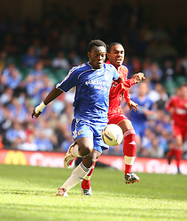 CARDIFF, WALES - SUNDAY, AUGUST 13th, 2006: Liverpool's Florent Sinama-Pongolle and Chelsea's Michael Essien during the Community Shield match at the Millennium Stadium. (Pic by David Rawcliffe/Propaganda)