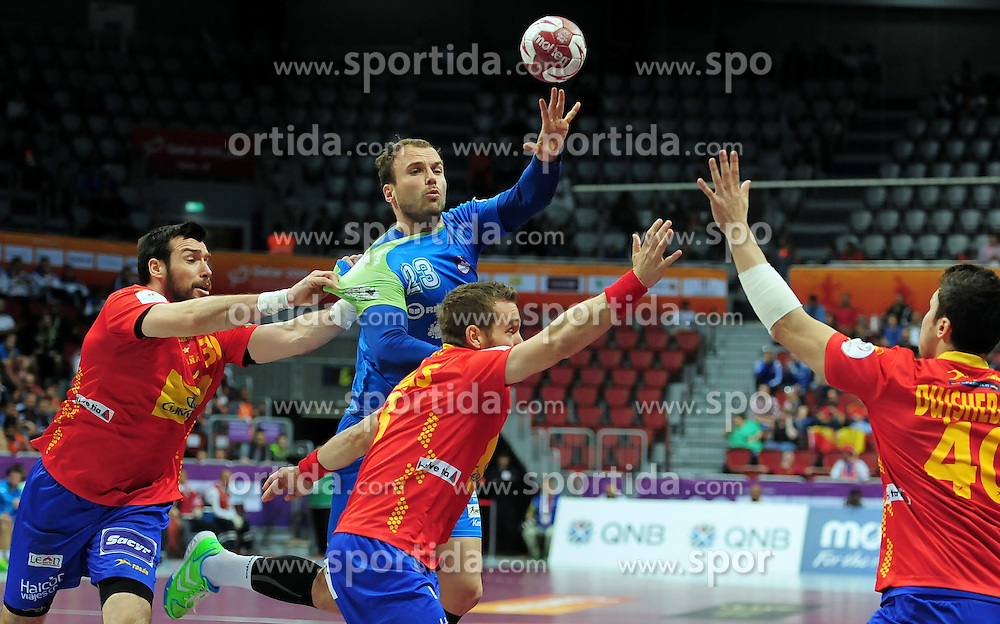 Uros Zorman #23 of Slovenia during handball match between National Teams of Slovenia and Spain at Day 9 of 24th Men's Handball World Championship Qatar 2015 on January 23, 2015 in Duhail Handball Sports Hall, Doha, Qatar. Photo by Slavko Kolar / Sportida