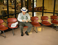 a man waits for his flight at Vieques Airport in Puerto Rico