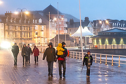 © London News Pictures. 31/12/2017. Aberystwyth, UK.  Storm Dylan sweeps over Aberystwyth , on the west coast of Wales, bringing cold gale force 7 wind,  gusting to 32 mph,  and driving bands of icy rain and hail. Photo credit: Keith Morris/LNP