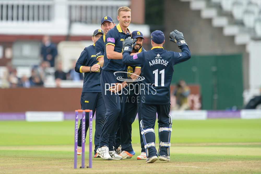 Oliver Hannon-Dalby of Warwickshire celebrates with team-mates after the dismissal of Ben Foakes of Surrey during the Royal London One Day Cup match between Warwickshire County Cricket Club and Surrey County Cricket Club at Lord's Cricket Ground, St John's Wood, United Kingdom on 17 September 2016. Photo by David Vokes.