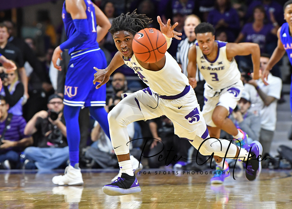 MANHATTAN, KS - FEBRUARY 05:  Cartier Diarra #2 of the Kansas State Wildcats chases down a loose ball against the Kansas Jayhawks during the second half on February 5, 2019 at Bramlage Coliseum in Manhattan, Kansas.  (Photo by Peter G. Aiken/Getty Images) *** Local Caption ***Cartier Diarra