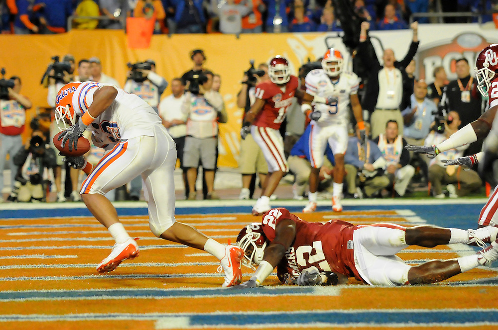 January 8, 2009: Brody Eldridge of the Florida Gators scores a touchdown as Cade Holliway of the Oklahoma Sooners defends during the NCAA football game between the Florida Gators and the Oklahoma Sooners in the 2009 BCS National Championship Game. The Gators defeated the Sooners 24-14.