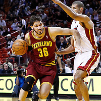 24 January 2012: Cleveland Cavaliers small forward Omri Cassi (36) drives past Miami Heat small forward Shane Battier (31) during the Miami Heat 92-85 victory over the Cleveland Cavaliers at the AmericanAirlines Arena, Miami, Florida, USA.
