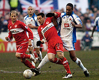 Photo: Leigh Quinnell.<br /> Nuneaton Borough v Middlesbrough. The FA Cup.<br /> 07/01/2006. Nuneatons Brian Quailey gives Middlesbroughs  Doriva a hard time.