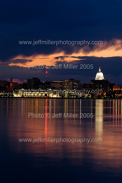 The downtown Madison, WI skyline, including the Monona Terrace Community and Convention Center, at left, and Wisconsin State Capitol Building dome, at right, reflects off Lake Monona after sunset. The view is seen from Wyldhaven Park in Monona.. Photo © Jeff Miller 2005 - all rights reserved.www.jeffmillerphotography.com  ?  608-250-2374.Date:  05/05    File#:   D100 digital camera frame 2244