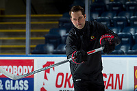 KELOWNA, CANADA - OCTOBER 20: Associate coach, Kyle Gustafson passes the puck to players during morning skate at the Kelowna Rockets on October 20, 2017 at Prospera Place in Kelowna, British Columbia, Canada.  (Photo by Marissa Baecker/Shoot the Breeze)  *** Local Caption ***