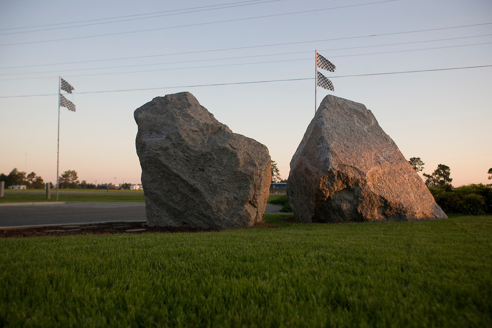 Two granite rocks outside of the Rockingham Speedway. The one on the left is the original rock, engraved with all of the winners of past NASCAR races, while the one on the right was placed there after Andy Hillenburg purchased the track in 2007. .