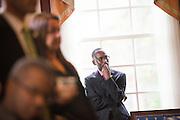 Dr. Jacob Okumu listens to listen to LaTasha Watts speak at a Ohio Reach Grant Acceptance event in Baker Center. Photo by Ben Siegel/ © Ohio University