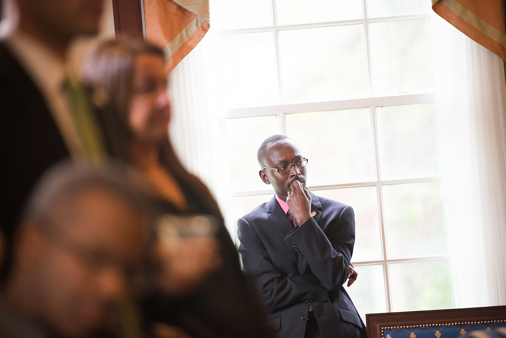 Dr. Jacob Okumu listens to listen to LaTasha Watts speak at a Ohio Reach Grant Acceptance event in Baker Center. Photo by Ben Siegel/ © Ohio University
