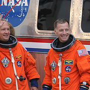 The space shuttle Atlantis astronauts, pilot Doug Hurley and commander Chris Ferguson wave after leaving the operations and check-out building on their way to the pad at the Kennedy Space Center Friday, July 8, 2011, in Cape Canaveral, Fla. Shuttle Atlantis is scheduled to launch on Friday, July 8 and is the 135th and final space shuttle launch for NASA..  (AP Photo/Alex Menendez)