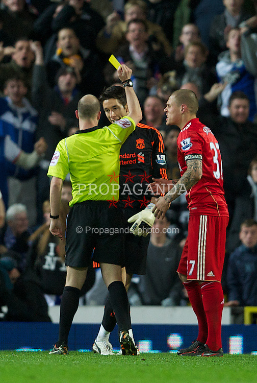 BLACKBURN, ENGLAND - Tuesday, April 10, 2012: Liverpool's goalkeeper Brad Jones is lucky only to get a yellow card from referee Anthony Taylor against Blackburn Rovers during the Premiership match at Ewood Park. (Pic by David Rawcliffe/Propaganda)
