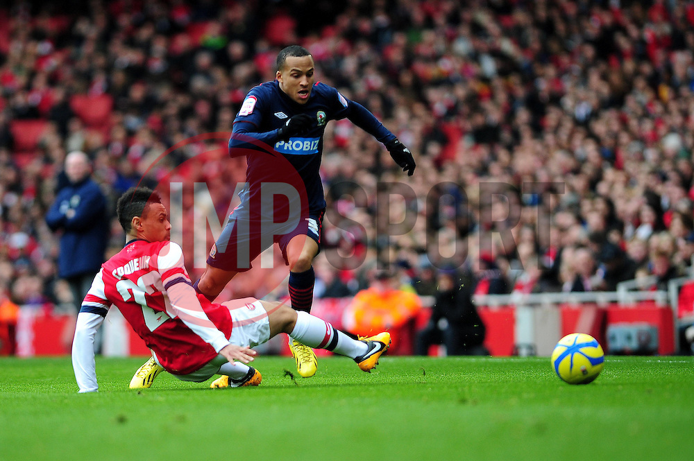 Blackburn Rovers' Martin Olsson passes a slide tackle from Arsenal's Francis Coquelin - Photo mandatory by-line: Dougie Allward/JMP - Tel: Mobile: 07966 386802 16/02/2013 - SPORT - FOOTBALL - Emirates Stadium - London -  Arsenal V Blackburn Rovers - FA Cup - Fifth Round